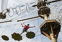 Crossing over obstacles on the Monkey Trunks Rope Course.  (Karen Bobota Photographer)