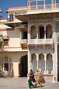 Tourists at The Maharaja of Jaipur's Moon Palace with flags to show that Maharaja is in residence in Jaipur, Rajasthan, India