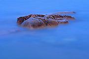 Crashing waves over shorline rocks st dusk<br /> Killarney Provincial PArk<br /> Ontario<br /> Canada