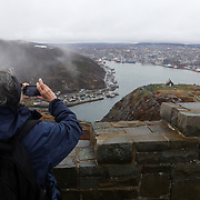 Gisele Bigaouette (cq), who is visiting from Montreal, takes a picture of the city atop Signal Hill near Cabot Tower in St. John's, Newfoundland and Labrador, Canada, on Monday, June 3, 2019. THE BLADE/KURT STEISS <br /> MAG NewfoundlandXX