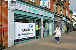 Covid vaccination centre in local pharmacy, Reading, UK March 2021