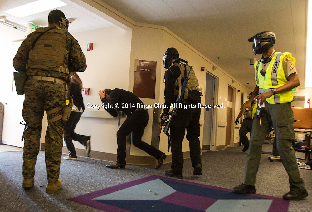 Multiple law enforcement agencies along with Los Angeles County sheriff's Tactics and Survival Training Unit, the Pasadena police and fire departments, took part in the drills, which were designed to help the agencies work together in emergencies at Huntington Memorial Hospital in Pasadena, California, on Friday, May 9, 2014. <br />  (Photo by Ringo Chiu/PHOTOFORMULA.com)