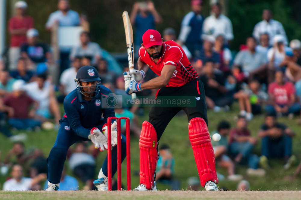 September 22, 2018 - Morrisville, North Carolina, US - Sept. 22, 2018 - Morrisville N.C., USA - Team Canada HAMZA TARIQ (61) in bat with Team USA MOHAMMED KHALEEL (2) behind the wicket during the ICC World T20 America's ''A'' Qualifier cricket match between USA and Canada. Both teams played to a 140/8 tie with Canada winning the Super Over for the overall win. In addition to USA and Canada, the ICC World T20 America's ''A'' Qualifier also features Belize and Panama in the six-day tournament that ends Sept. 26. (Credit Image: © Timothy L. Hale/ZUMA Wire)