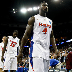 Mar 26, 2011; New Orleans, LA; Florida Gators players Patric Young (4) Vernon Macklin (32), Erik Murphy (33) and Will Yeguete (15) walk off the court following a loss to the Butler Bulldogs in the semifinals of the southeast regional of the 2011 NCAA men's basketball tournament at New Orleans Arena. Butler defeated Florida 74-71.  Mandatory Credit: Derick E. Hingle