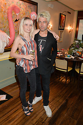 TIM NOBLE and SCARLETT CARLOS CLARKE at a dinner hosted by Kate Spade NY to celebrate Chelsea in Bloom held at Daphne's, 112 Draycott Avenue, London on 20th May 2015.