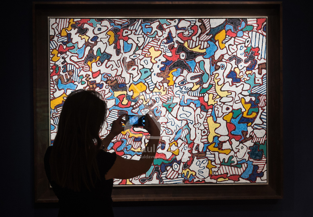 Christie's, London, March 3rd 2017. PICTURED: A woman photographs Jean Dubuffet's Étra et paraitre (To Be and To Seem), oil on canvass, which is expected to fetch between £7-10 million.<br /> Fine art auctioneers Christies hold a press preview for their Post-War and Contemporary Art auctions to be held on March 7th and 8th.