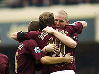 Photo: Chris Ratcliffe.<br />Arsenal v West Bromwich Albion. The Barclays Premiership. 15/04/2006.<br />Dennis Bergkamp of Arsenal celebrates his goal with Philippe Senderos and Matthieu Flamini