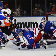 Ryan McDonagh, (centre), New York Rangers, and the Rangers defense protect the net as Wayne Simmonds, Flyers, challenges during the New York Rangers Vs Philadelphia Flyers, NHL regular season game at Madison Square Garden, New York, USA. 26th March 2014. Photo Tim Clayton