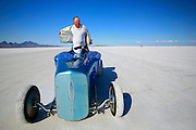 The best cars-people-atmosphere-photos of 2009 Bonneville Speed Week Veteran driver, Willie Glass of Sandston, VA. pulls off his fire suit after making a run in his Wasted Willies Flatheads Roadster, August 9, 2009.  Photos by Colin E. Braley
