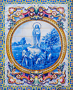 Our lady of Fatima (1917 appearance of the Virgin Mary in Fatima, Portugal) Christian Religious art in hand painted ceramic tiles. Photographed in Nazare, Portugal