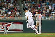 Minnesota Twins catcher Joe Mauer #7 rounds the bases after hitting a home run against the Baltimore Orioles at Target Field in Minneapolis, Minnesota on July 16, 2012.  The Twins defeated the Orioles 19 to 7 setting a Target Field record for runs scored by the Twins.  © 2012 Ben Krause