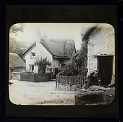 Magic lantern slide of white thatched village cottages in rural location possibly Wessex, England, UK circa 1900