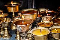 Yak butter candles burning in a monastery near Boudhanath Stupa, Kathmandu, Nepal.