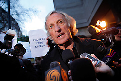 © under license to London News Pictures.  John Pilger speaks to journalists outside Westminster Magistrates court  (07/12/10) where Julian Assange appeared on sexual assault charges. Photo credit should read: Olivia Harris/ London News