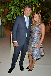 The HON.PEREGRINE HOOD and his wife SERENA at a dinner hosted by Cartier in celebration of The Chelsea Flower Show held at The Hurlingham Club, London on 19th May 2014.