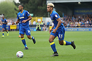 AFC Wimbledon striker Lyle Taylor (33) dribbling during the EFL Sky Bet League 1 match between AFC Wimbledon and Oldham Athletic at the Cherry Red Records Stadium, Kingston, England on 21 April 2018. Picture by Matthew Redman.