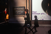 Months before the new Millennium of 2000, women shoppers walk along a sunlit Oxford Street, outside the Selfridges department store, on 19th September 1999, in London, England.