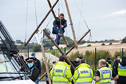 West Hyde, UK. 9th September, 2020. An anti-HS2 activist releases herself from a tripod used to block one of several entrances to the Chiltern Tunnel South Portal site for the HS2 high-speed rail link for the entire day. The protest action, at the site from which HS2 Ltd intends to drill a 10-mile tunnel through the Chilterns, was intended to remind Prime Minister Boris Johnson that he committed to remove deforestation from supply chains and to provide legal protection for 30% of UK land for biodiversity by 2030 at the first UN Summit on Biodiversity on 30th September.