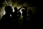 """US soldiers from Spartans Task Force during Salsa dancing lessons on """"Latin night"""" at the MWR of FOB Shank in Logar province, Afghanistan on Sunday, May 31st 2009...Photo: Guilad Kahn."""