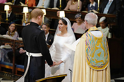The Prince of Wales leads Meghan Markle up the aisle of St George's Chapel, Windsor Castle for her wedding to Prince Harry.