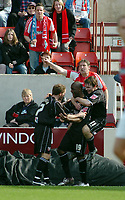 Photo: Kevin Poolman.<br />Swindon Town v Brentford. Coca Cola League 1. 22/04/2006. Callum Willock and Brentford players celebrate the third goal.