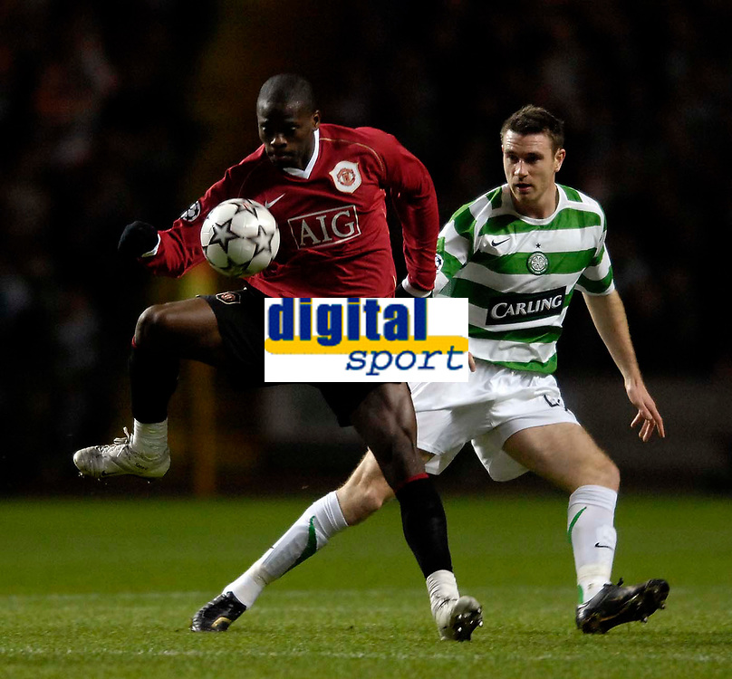 Photo: Jed Wee.<br /> Glasgow Celtic v Manchester United. UEFA Champions League, Group F. 21/11/2006.<br /> <br /> Manchester United's Louis Saha (L) controls the ball as Celtic's Stephen McManus looks on.
