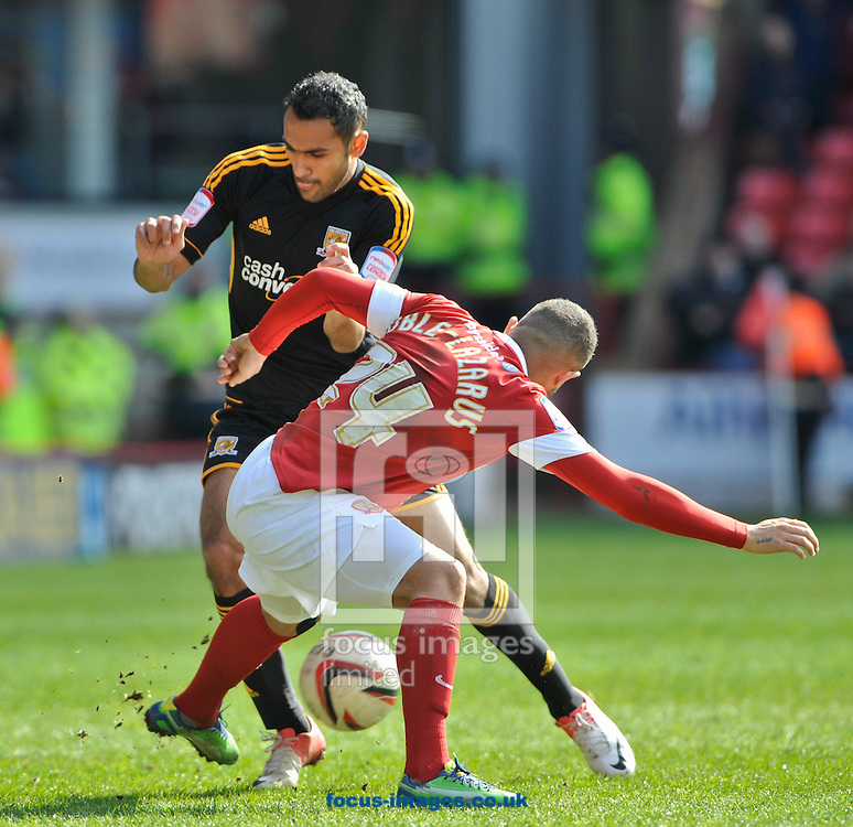 Picture by Richard Land/Focus Images Ltd +44 7713 507003.27/04/2013.Reuben Noble-Lazarus of Barnsley stops Ahmed Elmohamady of Hull City during the npower Championship match at Oakwell, Barnsley.
