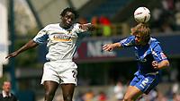 Fotball<br /> England 2004/2005<br /> Foto: SBI/Digitalsport<br /> NORWAY ONLY<br /> <br /> Millwall V Burnley<br /> Coca-Cola Championship<br /> The Den.<br /> 08/05/2005<br /> <br /> Millwall's Matt Lawrence heads the ball as Burnley's Ade Akinbiyi jumps.