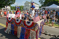 The Sawyer Lake float sports their red white and blue for the Gilmanton 4th of July parade Thursday morning.  (Karen Bobotas/for the Laconia Daily Sun)