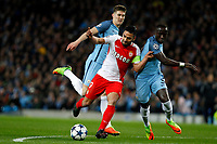 Football - 2016 / 2017 UEFA Champions League - Round of Sixteen, First Leg: Manchester City vs. Monaco<br /> <br /> Radamel Falcao Garcia of Monaco holds off Bacary Sagna and John Stones of Manchester City during the match at the Etihad Stadium.<br /> <br /> COLORSPORT