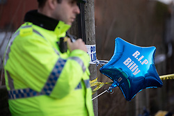 © Licensed to London News Pictures . 29/12/2018 . Wigan , UK . Tributes at the scene where police have taped off a stretch of Bickershaw Lane in Abram . GMP report they have arrested two people on suspicion of attempted murder and for conspiracy to commit attempted murder , respectively , after a 21-year-old man , identified locally as Billy Livesley , sustained life-threatening injuries yesterday evening (Friday 28th December 2018) . Photo credit : Joel Goodman/LNP