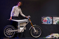"""© Licensed to London News Pictures. 11/09/2018. LONDON, UK. Karl Ytterborn, founder of CAKE, poses with the """"Kalk electric motorbike"""", designed by CAKE, at a preview of the 87 nominees for the eleventh Beazley Designs of the Year exhibition and awards at the Design Museum in Kensington.  The off-road motorbike weighs under 70 kg and can be recharged using solar panels. The exhibition runs 12 September to 6 January 2019 and celebrates the most innovative designs of the last year.  Photo credit: Stephen Chung/LNP"""