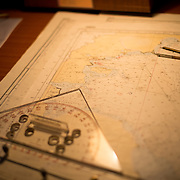 Navigation charts on a map table on the bridge of an Antarctic cruise ship, the Polar Pioneer.