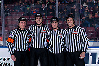 KELOWNA, BC - DECEMBER 18: Referee Fraser Lawrence, linesman Josh Albinati, referee Matt Hicketts and linesman Dustin Minty pose for a photo on the ice at the Kelowna Rockets against the Vancouver Giants at Prospera Place on December 18, 2019 in Kelowna, Canada. (Photo by Marissa Baecker/Shoot the Breeze)