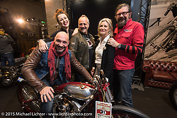 Andrea Radaelli (from Radikal Choppers) seated on the Radikal Choppers first place winner (in the EICMA Custom Show) with LowRide Magazine staff Sara Jukic, Danilo Seclì, Marie-Line Thioulouze and Giuseppe Roncen during EICMA, the largest international motorcycle exhibition in the world. Milan, Italy. November 21, 2015.  Photography ©2015 Michael Lichter.