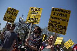 April 14, 2018 - Washington, DC, United States - Protestors from the ANSWER Coalition stage a protest against U.S. airstrikes in Syria, along Pennsylvania Avenue in front of the White House. (Credit Image: © Michael Candelori/Pacific Press via ZUMA Wire)