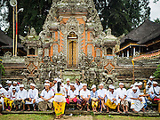 19 JULY 2016 - TAMPAKSIRING, GIANYAR, BALI, INDONESIA:  Balinese Hindus gather in the plaza of the temple on the first day of a ceremony to honor the anniversary Pura Agung temple, one of the most important Hindu temples on Bali. This year's ceremony is the most important in years because it falls on the 50 year cycle of the temple's founding. This year's ceremony lasts for 11 days.     PHOTO BY JACK KURTZ