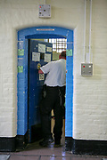 A prison officer checks on a prisoner in his cell on the Vulnerable Prisoners Unit of HM Prison Wandsworth is a Category B men's prison at Wandsworth in the London Borough of Wandsworth, South West London, United Kingdom. It is operated by Her Majesty's Prison Service and is one of the largest prisons in the UK with a population over 1500 people. (photo by Andy Aitchison)