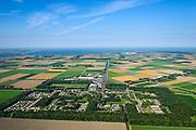 Nederland, Flevoland, Nagele, 27-08-2013;<br /> Dorp Nagele in de Noordoostpolder, bijna geheel ontworpen door moderne architecten van de zogenaamde Delftse School. Aan de horizon Urk met het IJsselmeer.<br /> Village Nagele in the Northeast polder, almost entirely designed by modern architects in the 50s. Ijsselmeer in the back.<br /> luchtfoto (toeslag op standaard tarieven);<br /> aerial photo (additional fee required);<br /> copyright foto/photo Siebe Swart.
