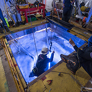 Beacon being lowered into McMurdo Sound to guide the robot back home. The beacon is only there as a backup, the robot will normally find its way home after making its run without use of the beacon.