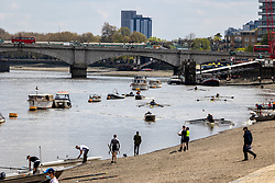 Licensed to London News Pictures. 01/05/2021. London, UK. Rowers take advantage of the Bank Holiday weekend along the Thames at Putney South West London today. This month Covid-19 restrictions were lifted with more freedoms to meet friends and have picnics in the parks as pubs and staycations open up for the long May Bank Holiday weekend with temperatures expected to be 14c in the South East with a possibility of rain forecast. Photo credit: Alex Lentati/LNP
