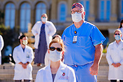 01 AUGUST 2020 - DES MOINES, IOWA: Dr. SCOTT THOMPSON, center, and other medical doctors at the Iowa State Capitol Saturday. About 50 doctors, medical professionals, and public health professionals from across Iowa came to the State Capitol to demand that Iowa Governor Kim Reynolds impose a mask mandate to control the spread of the coronavirus (SARS-CoV-2). Despite the continued spread of the coronavirus and rapidly increasing infection rate for COVID-19, the Governor has refused to impose a mask mandate or close businesses. For the week ending Saturday, Aug. 1, Iowa reported new 2,736 new cases of COVID-19.            PHOTO BY JACK KURTZ