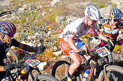 WELLINGTON SOUTH AFRICA - MARCH 22: Riders jostle for position as they try to maintain momentum on the loose terrain during stage three's 111km from Wellington to Worcester on March 22, 2018 in Western Cape, South Africa. Mountain bikers gather from around the world to compete in the 2018 ABSA Cape Epic, racing 8 days and 658km across the Western Cape with an accumulated 13 530m of climbing ascent, often referred to as the 'untamed race' the Cape Epic is said to be the toughest mountain bike event in the world. (Photo by Dino Lloyd)