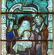 Stained glass window detail Presentation in the Temple, Hacheston church, Suffolk, England, UK c 1922 by Kempe and Co