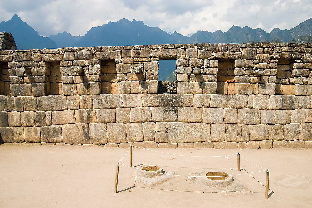 Two shallow stone dishes, believed to be filled with water to serve as an astronomical observatory, at Machu Picchu archaeological site, Peru