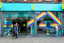 © Licensed to London News Pictures. 01/07/2019. LONDON, UK.  An EE store on Oxford Street is one of many retail stores in the capital's West End whose exteriors are decorated in rainbow colours in support of Pride Month.  Pride is an annual celebration of the LGBT+ community and culminates in the LGBT+ parade in the UK, with thousands of people travelling the route either by foot or on floats.  Photo credit: Stephen Chung/LNP