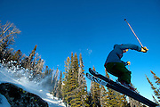 PRICE CHAMBERS / NEWS&GUIDE<br /> Justin DiMatteo pops off a rock near the Woolsey Woods at Jackson Hole Mountain Resort on Thursday. While the resort has opened more than 3,000 vertical feet of terrain to skiers, it advises caution in areas with little cover.