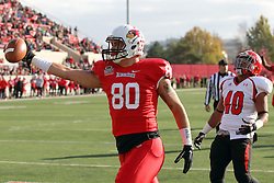 08 November 2014: James O'Shaughnessy holds the ball in the air after catching a pass for a touchdown while defender Jaylin Kelly has a look of disgust during an NCAA Missouri Valley Football Conference game between the Youngstown State Penguins and the Illinois State Redbirds at Hancock Stadium in Normal Illinois