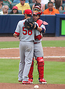 ATLANTA, GA - JULY 27:  Catcher Yadier Molina #4 of the St. Louis Cardinals congratulates pitcher Joe Kelly #58 before Kelly exits the game against the Atlanta Braves at Turner Field on July 27, 2013 in Atlanta, Georgia.  (Photo by Mike Zarrilli/Getty Images)