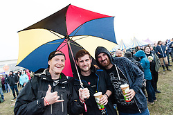 © Licensed to London News Pictures. 29/08/2015. Reading Festival, UK. Rain at Reading Festival - Festival goers in waterproof raincoats, ponchos and other rain gear at Reading Festival 2015, Day 2.  Photo credit: Richard Isaac/LNP